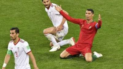 Iran drew with Portugal 1-1; while Spain narrowly escaped defeat against Morocco