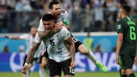 Marcus Rojo's stunning finish four minutes from time kept Lionel Messi and Argentina's World Cup hopes alive to see off Nigeria 2-1 on Tuesday and set up a last 16 meeting with France.
